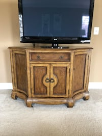 black wooden TV stand with flat screen television Haymarket, 20169
