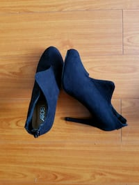 pair of black suede heeled shoes