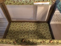 white and green floral travel cot 460 mi