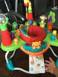 Baby's green and blue activity saucer