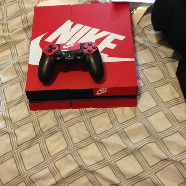 3ac9ea0409e5 Red and white Nike skin Sony PS4 console with matching wireless controller