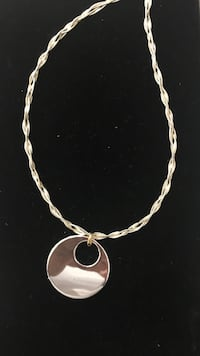 women's silver necklace with round pendant