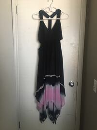 Never before worn brand name dress . Tags still on Calgary, T2Z 3X5