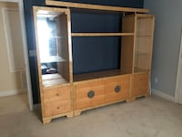 brown wooden TV hutch and flat screen TV Kissimmee, 34741