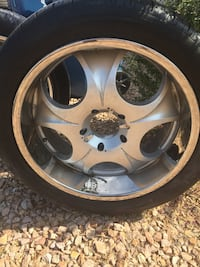 Gray spoked vehicle wheel with tire