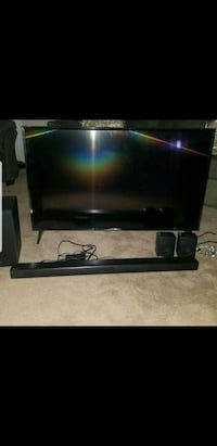 black flat screen TV with remote Indian Head, 20640