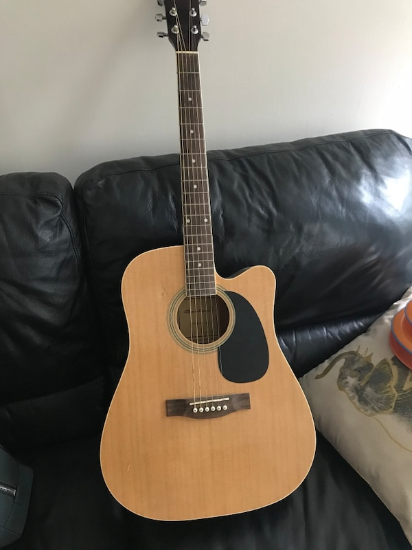 Brown and black classic guitar with cover