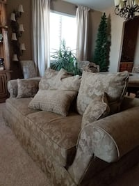 Moss colored 3-seat sofa with pillows