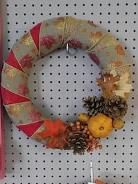 red and brown pine cone wreath