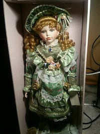 female porcelain doll in green pleated long-sleeve Sterling Heights, 48313