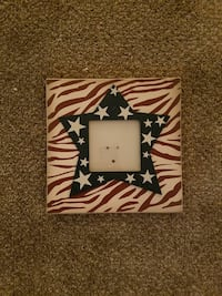 white, red, and blue wooden photo frame