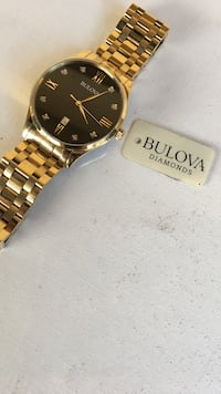 round gold-colored Bulova analog watch with link band West Covina, 91790
