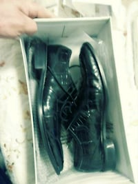pair of black leather dress shoes Rolla, 65401