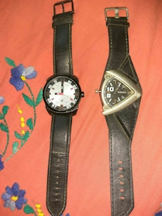 two black leather strap watches