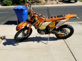 orange and black motocross dirt bike