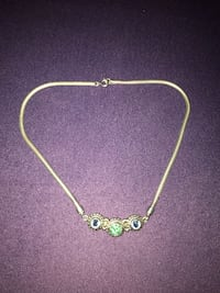 Sterling silver with blue topaz outer stones and peridot center. Santa Fe, 87508