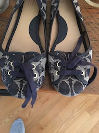 pair of black-and-gray peep toe pumps 715 km