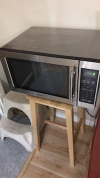 black and gray microwave oven 162 mi