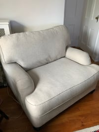 Beige/natural color fabric oversized sofa chair with throw pillow New Rochelle