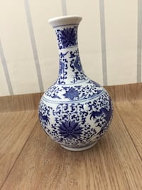 white and blue ceramic vase