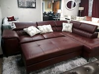 Modern bonded leather sectional with ottoman  1159 mi