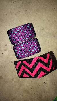 two black and pink chevron print pouches