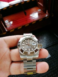 round silver Rolex analog watch with silver link bracelet Singapore