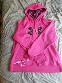 pink Under Armour pullover hoodie with text overlay Calgary, T2E 1T8