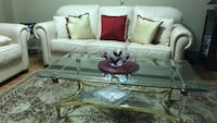 Glass  with gold stand coffee table