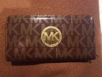 Monogrammed black and brown Michael Kors leather clutch bag