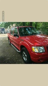 red Ford Explorer Sport Trac crew-cab pickup truck