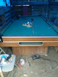 brown and green pool table