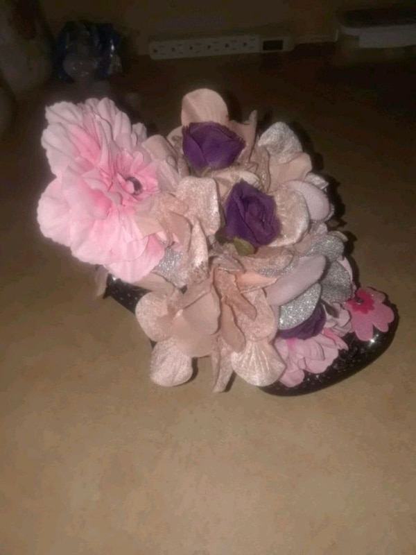 white and pink floral shoes