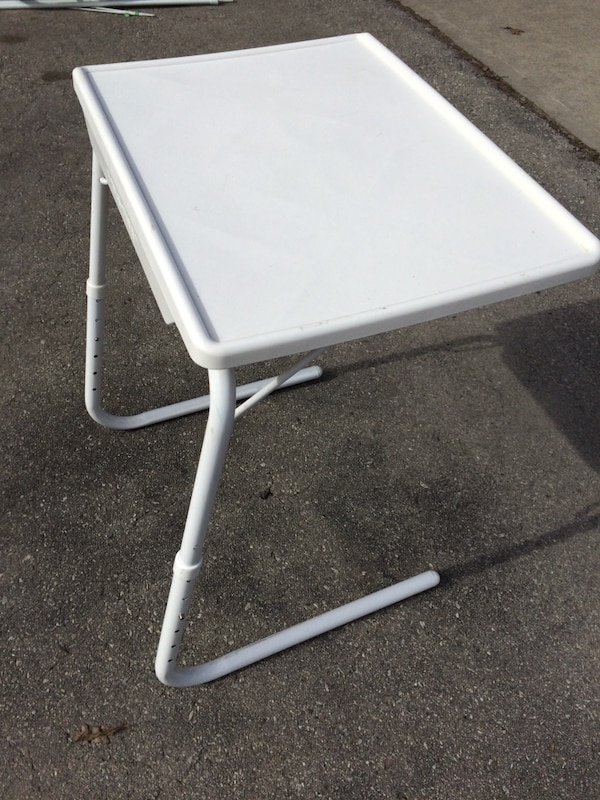 White adjustable table.