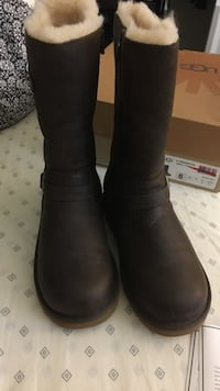 Pair of women's brown leather sheepskin boots