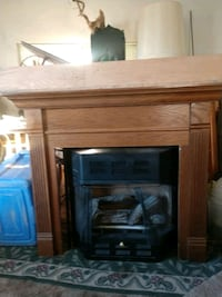 brown wooden framed electric fireplace