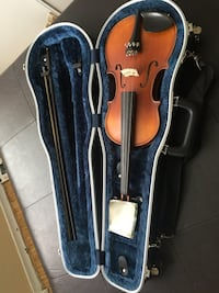 Brown violin with bow in case Mississauga
