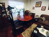 round brown wooden table with four chairs dining s Pickering, L1V 7K1