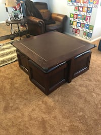 Coffee table with 4 seats that are also storage. One wheel needs to be replaced. Simi Valley, 93063
