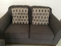 two brown wooden framed gray padded armchairs Springfield, 62702