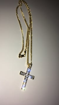 Iced out cross with gold plated Cuban link  Winnipeg, R3G 1H2