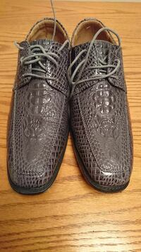 pair of gray crocodile skin loafers