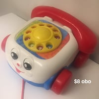 white and red Fisher-Price rotary phone toy New York, 10027