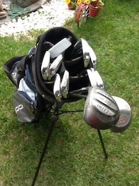 Black and gray golf bag with golf clubs Men's right handed.    (31)