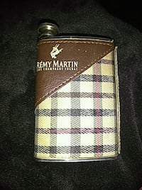 brown and beige Remy Martin champagne and cognac flask 2342 mi