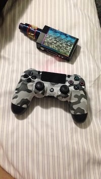 black and gray camouflage Sony PS4 controller Dartmouth, B2X 3S9