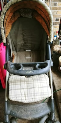 baby's black and green Evenflo stroller
