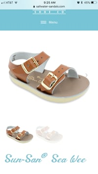 unpaired brown and white leather sandals null