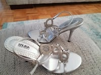 pair of white leather open toe ankle strap sandals Richmond Hill, L4B