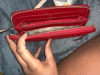 red and brown leather wristlet 506 mi